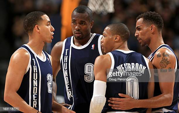 Kevin Martin Serge Ibaka Russell Westbrook and Thabo Sefolosha of the Oklahoma City Thunder talk during a break in the action against the Denver...