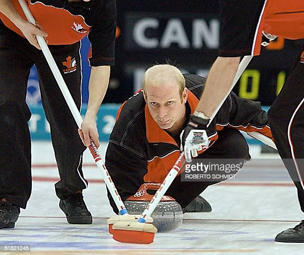 Kevin Martin the skip for curling team from Canada closely watches the delivery of his stone 22 February 2002 during his team's gold medal match...