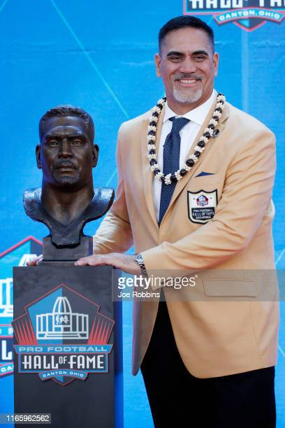 Kevin Mawae and his bust during his enshrinement to the Pro Football Hall of Fame at Tom Benson Hall Of Fame Stadium on August 3 2019 in Canton Ohio