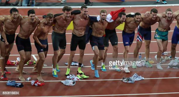 Kevin Mayer of France celebrates with the rest of the competitors after winning the men's decathlon during day nine of the 16th IAAF World Athletics...