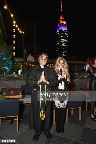 Kevin Mazur and Jennifer Mazur attend Heidi Klum's 18th Annual Halloween Party presented by Party City and SVEDKA Vodka at Magic Hour Rooftop Bar...