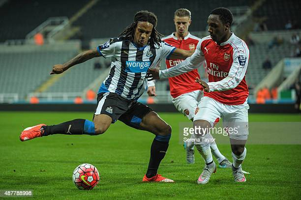 Kevin Mbabu of Newcastle controls the ball whilst being challenged by Kaylen Hinds of Arsenal during the U21 Premier league match between Newcastle...