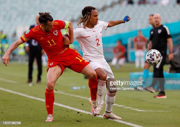 Kevin Mbabu of Switzerland shields the ball from Gareth Bale of Wales during the UEFA Euro 2020 Championship Group A match between Wales and...