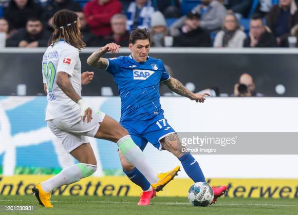 Kevin Mbabu of VfL Wolfsburg and Steven Zuber of TSG Hoffenheim battle for the ball during the Bundesliga match between TSG 1899 Hoffenheim and VfL...