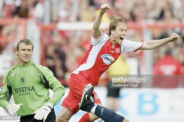 Kevin Mc Kenna of Cottbus celebrates scoring the third goal and Michael Hofmann of 1860 looks dejected during the Second Bundesliga match between...