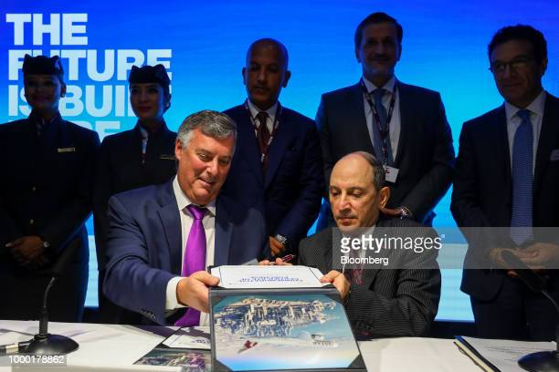Kevin McAllister chief executive officer of commercialairplanes at Boeing Co left and Akbar Al Baker chief executive officer of Qatar Airways right...