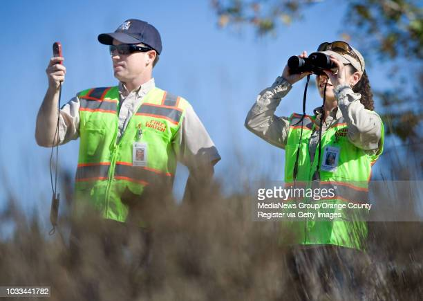 Kevin McArthur and Brittany Mendelsohn with Irvine Ranch Conservancy keep an eye on fire conditions at Peters Canyon Regional Park in Orange on...