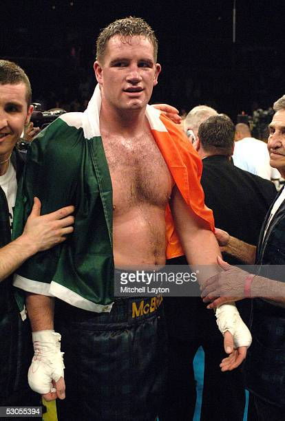 Kevin McBride celebrates with his cornermen after defeating Mike Tyson during their heavyweight bout at the MCI Center June 11 2005 in Washington DC...