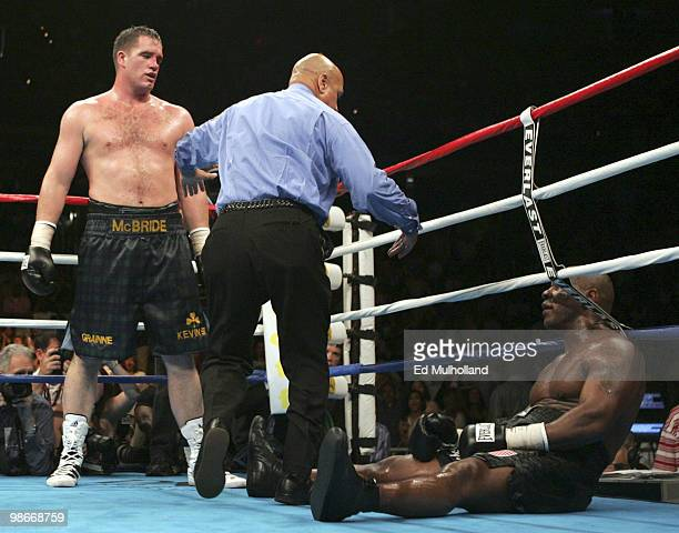 Kevin McBride looks down at a fallen Mike Tyson during the 6th round of their fight at the MCI Center in Washington DC McBride won the fight when...