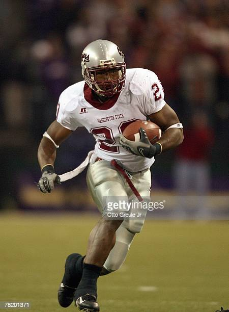 Kevin McCall of the Washington State Cougars carries the ball during the 100th Apple Cup Game against the Washington Huskies at Husky Stadium on...