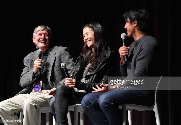 "Kevin McCarey Elizabeth Chai Vasarhelyi and Jimmy Chin speak onstage at the Docs to Watch ""Free Solo"" QA during the 21st SCAD Savannah Film Festival..."