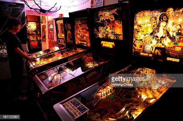 Kevin McCarthy is in action during the pinball tournament League play is 20 pinballers in Lyons at Lyons Classic Pinball on Friday 30 pinball...