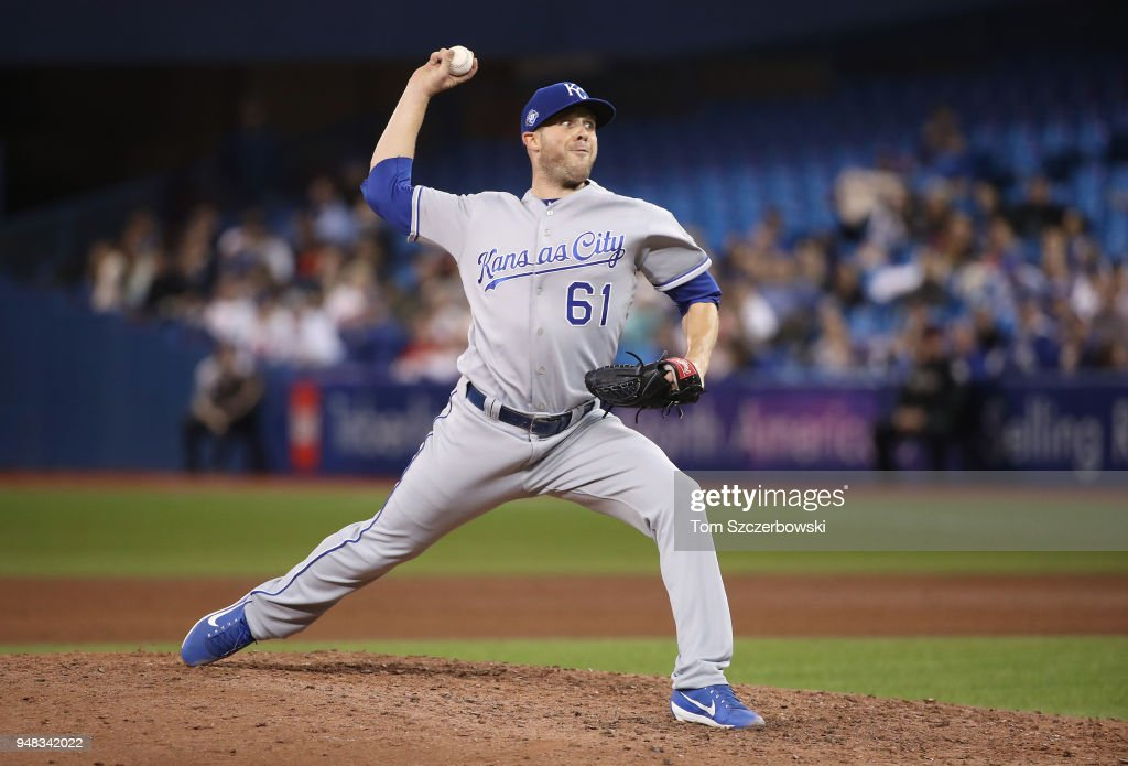 Kevin McCarthy #61 of the Kansas City Royals delivers a pitch in the seventh inning during MLB game action against the Toronto Blue Jays at Rogers Centre on April 18, 2018 in Toronto, Canada.