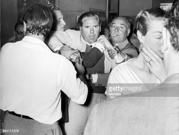 Kevin McClory film producer being restrained in bar room brawl with London film critic Leonard Mosley who gave a very negative review of his film...