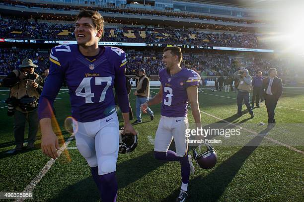 Kevin McDermott and Blair Walsh of the Minnesota Vikings celebrate a win of the game against the St Louis Rams in overtime on November 8 2015 at TCF...