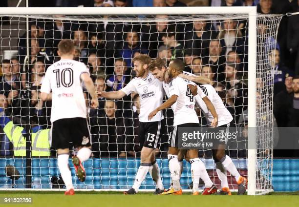 Kevin McDonald of Fulham celebrates after scoring his sides first goal with his Fulham team mates during the Sky Bet Championship match between...