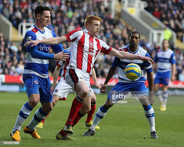 Kevin McDonald of Sheffield United is tackled by Sean Morrison od Reading during the FA Cup Fourth Round match between Reading v Sheffield United at...