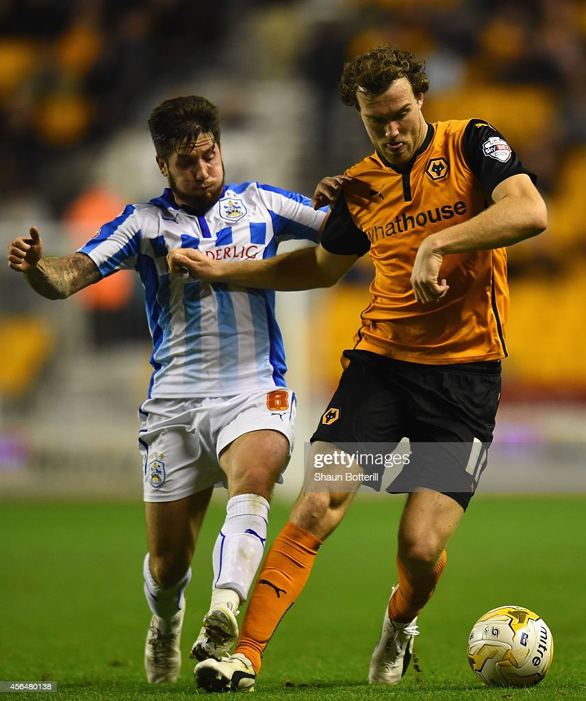 Kevin McDonald of Wolverhampton Wanderers is challenged by Jacob Butterfield of Huddersfield Town during the Sky Bet Championship match between Wolverhampton Wanderers and Huddersfield Town at Molineux on October 1, 2014 in Wolverhampton, England.
