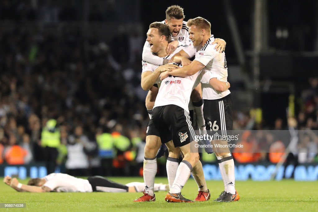Kevin McDonald, Oliver Norwood, Tomas Kalas and Tim Ream of Fulham celebrate getting into the playoff final during the Sky Bet Championship Play Off Semi Final:Second Leg match between Fulham and Derby County at Craven Cottage on May 14, 2018 in London, England.