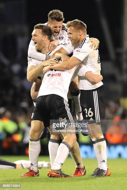 Kevin McDonald Oliver Norwood Tomas Kalas and Tim Ream of Fulham celebrate getting into the playoff final during the Sky Bet Championship Play Off...