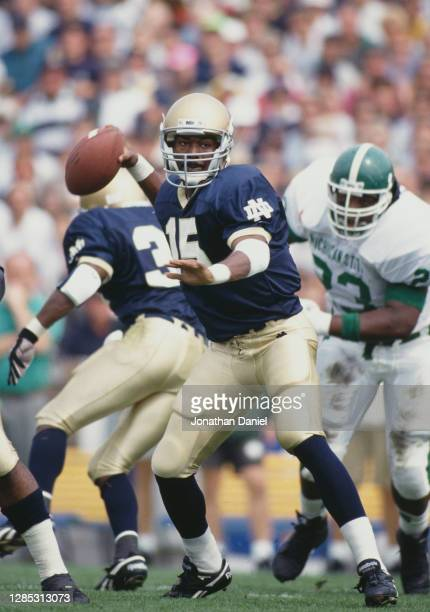 Kevin McDougal, Quarterback for the Notre Dame Fighting Irish prepares to throw the football during the NCAA Independent college football game...