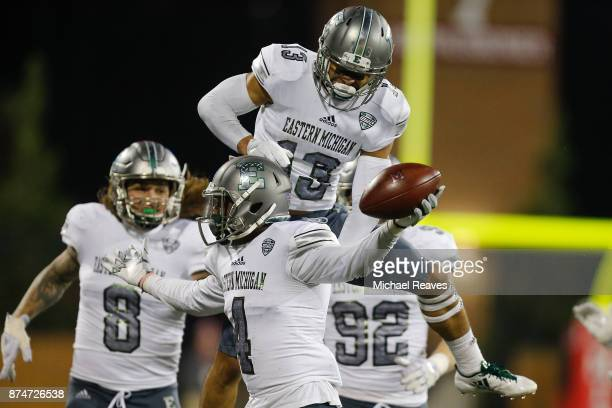 Kevin McGill of the Eastern Michigan Eagles celebrates with Justin Moody after a interception against the Miami Ohio Redhawks during the second half...