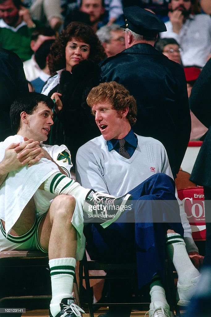 Kevin McHale #32 and Bill Walton #5 of the Boston Celtics talk on the bench during a game played in 1987 at the Boston Garden in Boston, Massachusetts.