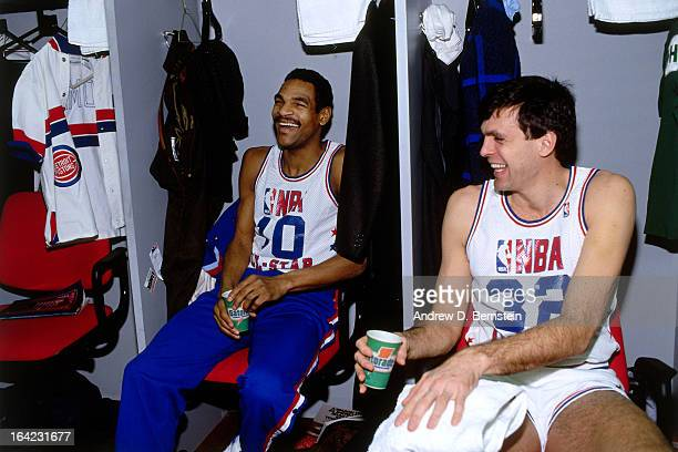 Kevin McHale and Maurice Cheeks of the Eastern Conference All Stars sit in the locker room prior to the 1988 NBA AllStar Game on February 7 1988 at...