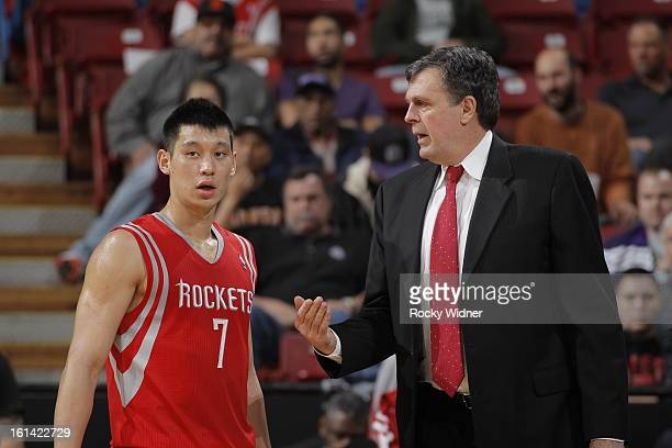 Kevin McHale head coach of the Houston Rockets talks with his guard Jeremy LIn during a break in action against the Sacramento Kings on February 10...