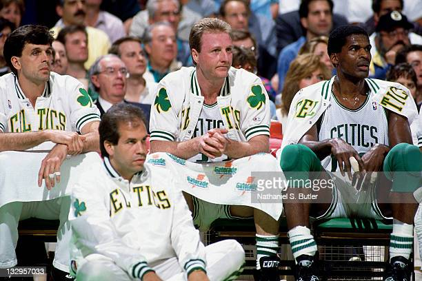 Kevin McHale Larry Bird and Robert Parish of the Boston Celtics sit on the bench circa 1991 at the Boston Garden in Boston Massachusetts NOTE TO USER...