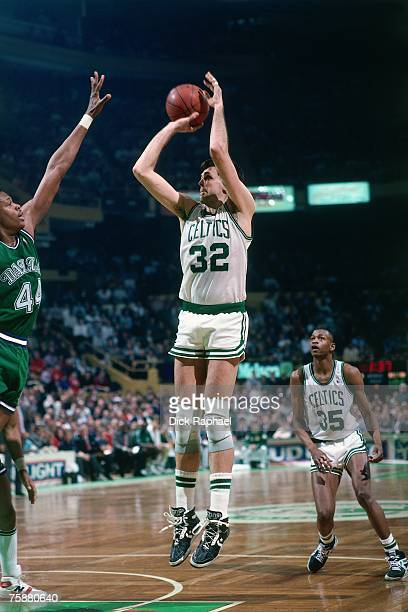 Kevin McHale of the Boston Celtics attempts a jump shot against the Dallas Mavericks during an NBA game circa 19801990 at the Boston Garden in Boston...