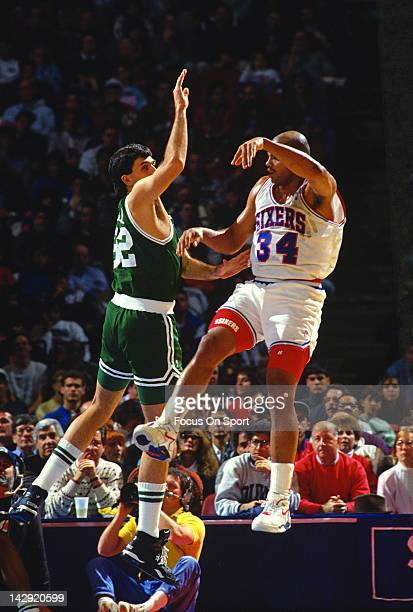 Kevin McHale of the Boston Celtics defends Charles Barkley of the Philadelphia 76ers during an NBA basketball game circa 1988 at the Spectrum in...