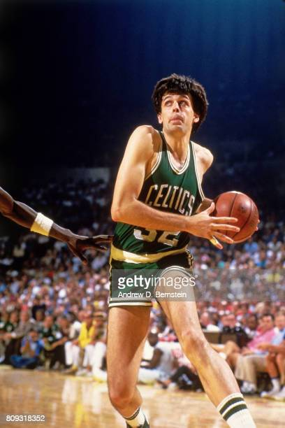 Kevin McHale of the Boston Celtics handles the ball against the Los Angeles Lakers during a game played circa 1988 at the Great Western Forumin...