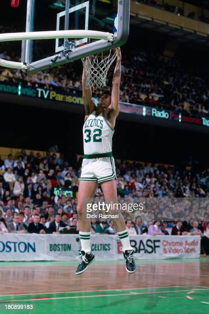 Kevin McHale of the Boston Celtics hangs on the rim after a dunk during a game played in 1986 at the Boston Garden in Boston Massachusetts NOTE TO...