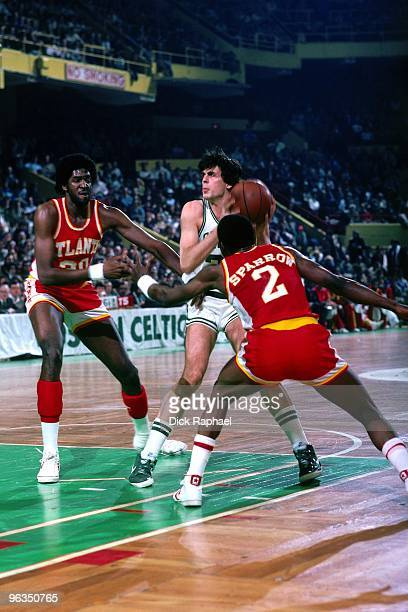 Kevin McHale of the Boston Celtics makes a move to the basket against Tree Rollins and Rory Sparrow of the Atlanta Hawks during a game played in 1982...