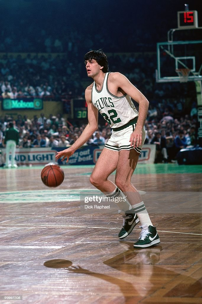 Kevin McHale #32 of the Boston Celtics moves the ball up court during a game played in 1983 at the Boston Garden in Boston, Massachusetts.