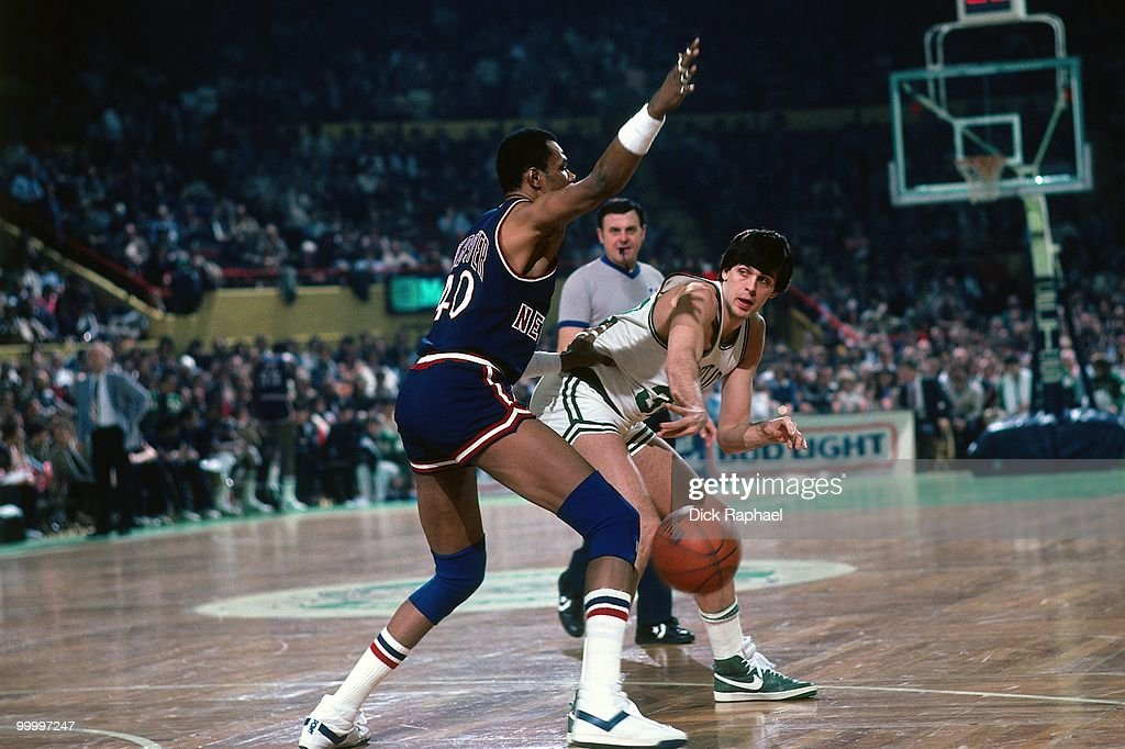 Kevin McHale #32 of the Boston Celtics passes against Marvin Webster #40 of the New York Knicks during a game played in 1983 at the Boston Garden in Boston, Massachusetts.