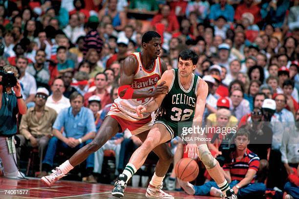 Kevin McHale of the Boston Celtics posts up against Kevin Willis of the Atlanta Hawks during a game played in 1988 at the Omni in Atlanta Georgia...