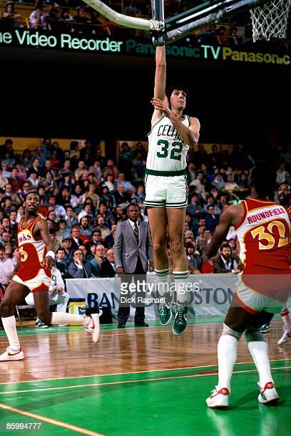 Kevin McHale of the Boston Celtics shoots a hook shot against Dan Roundfield of the Atlanta Hawks during a game played in 1983 at the Boston Garden...