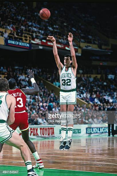 Kevin McHale of the Boston Celtics shoots against Larry Smith of the Houston Rockets during a game played circa 1989 at the Boston Garden in Boston...