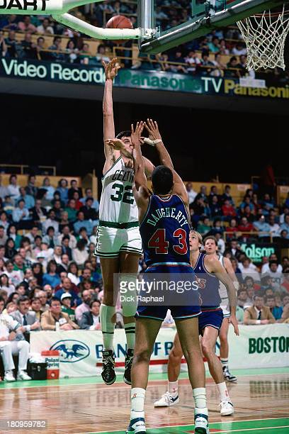 Kevin McHale of the Boston Celtics shoots against the Cleveland Cavaliers during a game circa 1988 at the Boston Garden in Boston Massachusetts NOTE...