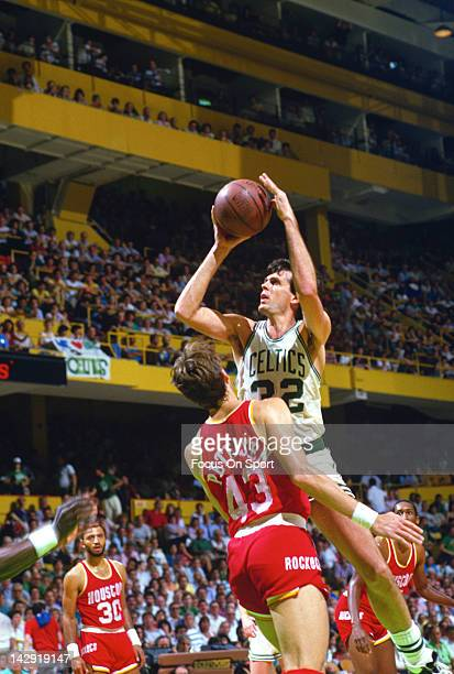 Kevin McHale of the Boston Celtics shoots over Jim Petersen of the Houston Rockets during an NBA basketball game circa 1986 at the Boston Garden in...