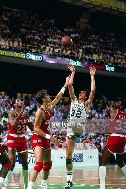 Kevin McHale of the Boston Celtics shoots over Jim Petersen of the Houston Rockets during a game circa at the Boston Garden in Boston Massachusetts...