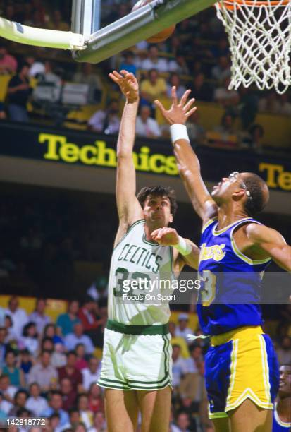 Kevin McHale of the Boston Celtics shoots over Kareem AbdulJabbar of the Los Angeles Lakers during the 1987 NBA Basketball Finals at the Boston...