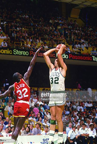 Kevin McHale of the Boston Celtics shoots over Louis Lloyd of the Houston Rockets during an NBA basketball game circa 1986 at the Boston Garden in...