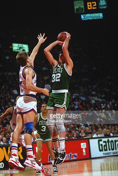 Kevin McHale of the Boston Celtics shoots over Mark Alarie of the Washington Bullets during an NBA basketball game circa 1988 at the Capital Center...