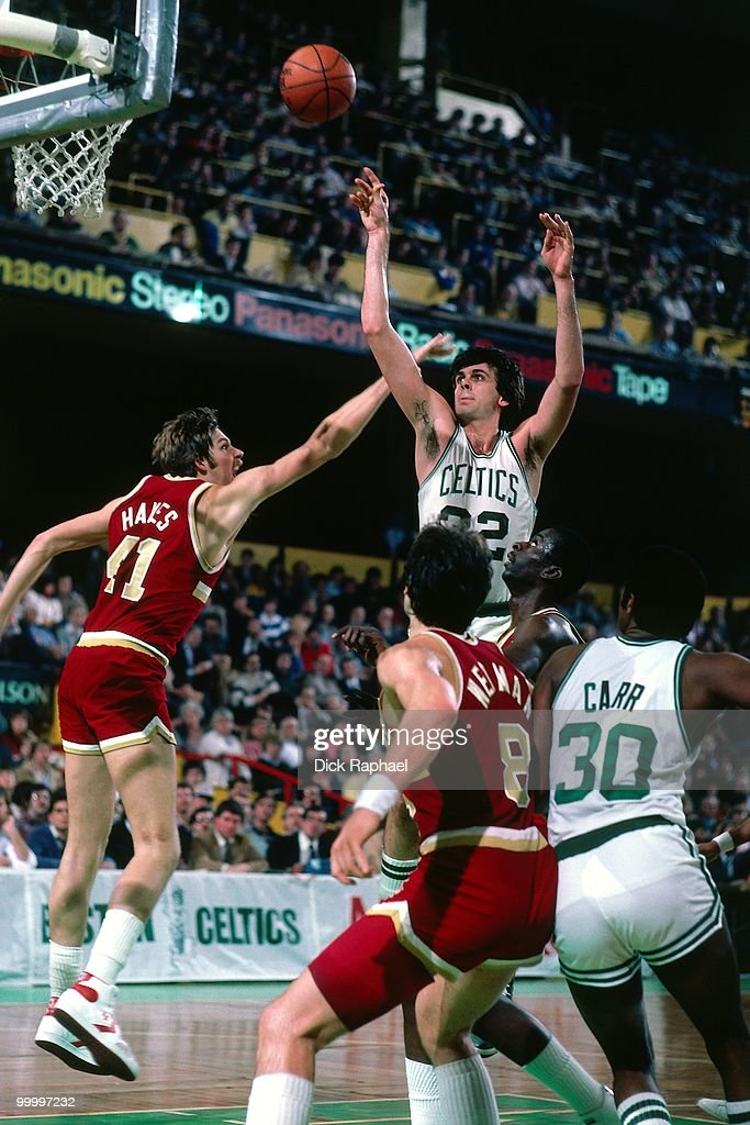 Kevin McHale #32 of the Boston Celtics shoots over Steve Hayes #41 of the Cleveland Cavaliers during a game played in 1983 at the Boston Garden in Boston, Massachusetts.