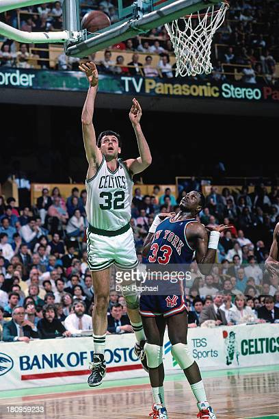 Kevin McHale of the Boston Celtics shoots the ball against Patrick Ewing of the New York Knicks during a game circa 1988 at the Boston Garden in...