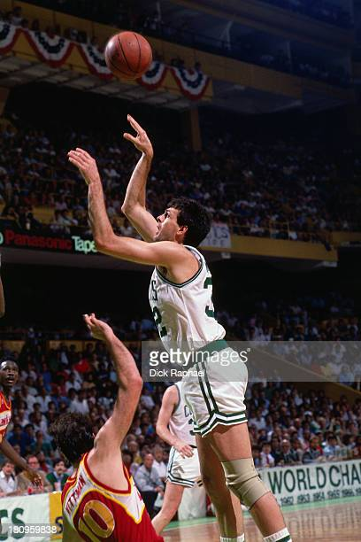 Kevin McHale of the Boston Celtics shoots the ball against the Atlanta Hawks during a game circa 1988 at the Boston Garden in Boston Massachusetts...