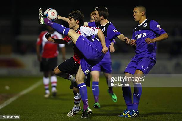 Kevin McIntyre of Chester City battles with John Goddard of Chester City during the Skrill Conference Premier match between Woking and Chester at the...